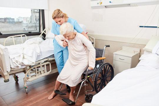 Nurse helps elderly woman in the wheelchair