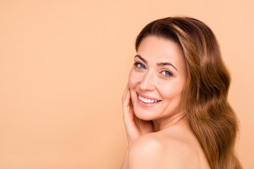Close up side profile photo beautiful amazing mature she her lady white teeth salon spa procedures aesthetic pretty ideal appearance nude arm hand palm touch cheek isolated pastel beige background