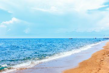 Calm blue mediterranean sea and yellow sand