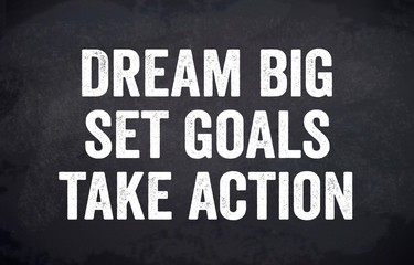 Black chalkboard or blackboard with dream big, set goals and take action