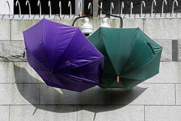Umbrellas are placed to block security cameras outside a police headquarters, during a demonstration demanding Hong Kong's leaders to step down and withdraw the extradition bill, in Hong Kong