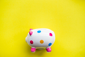 piggy bank on yellow paper background