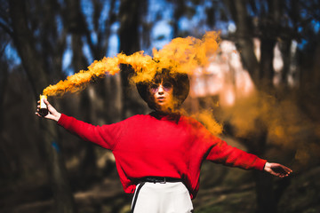 Girl with red smoke bomb. Hipster young girl send smoke signal. Emergency flare signal, smoke signal