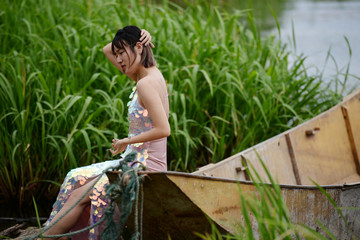 Yan Mengjie sits on a boat as she poses for photos near Erhai Lake in Dali