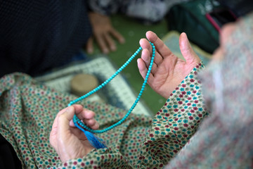 A worshipper holds a rosary during Friday prayers in Tehran