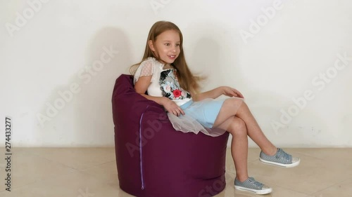 Fine Cute Little Girl Sitting On Purple Bean Bag Sofa For Living Bralicious Painted Fabric Chair Ideas Braliciousco