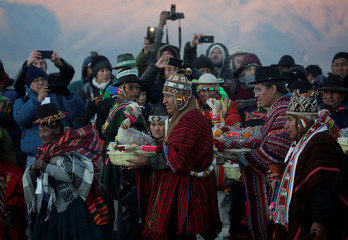 Bolivia's President Evo Morales holds an offering during a winter solstice ceremony that coincides with the Aymara Indian New Year in Tiwanaku