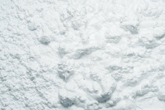 White foam texture abstract art background. Bubbled whipped cream design surface.