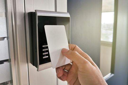 Hand using Key card;access control concept