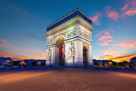 Arc de Triomphe de Paris at night in Paris, France.