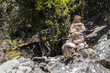 Stacked stones as a guide for hikers in Table Mountain National Park in Cape Town, South Africa.