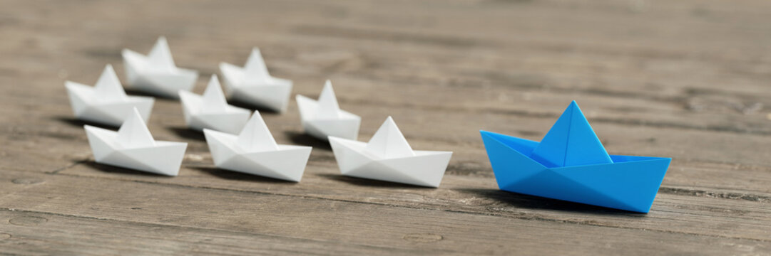 Management concept with origami boats