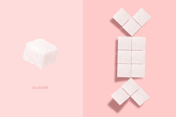 Creative layout made of sugar cubes on a pink background
