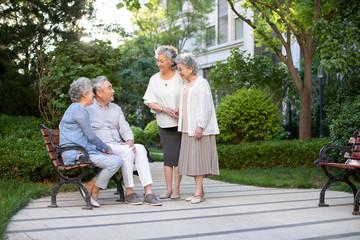 Senior friends talking in nursing home