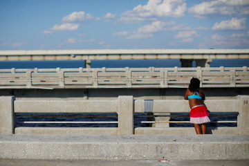 Six year-old Illiana Talic fishes from a pier in St. Petersburg