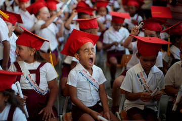 A child yawns during a graduation ceremony at a school in Havana
