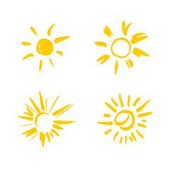 Four painted yellow suns. Vector solar symbols set.