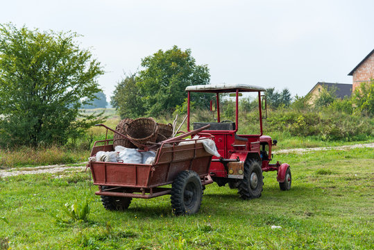 Tractor with full trailer of harvest. Harvesting, autumn