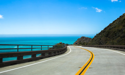 Curving Highway along Blue Sea on California Highway 1