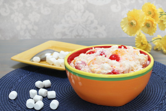 Ambrosia salad of oranges, cherries, coconut and marshmallows.