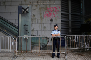 Marks from thrown eggs and anti-extradition graffiti is seen on the walls of the Hong Kong Police headquarters in Hong Kong, China