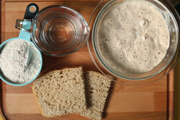 Zelfklevend Fotobehang Brood Sourdough bread making process from start to finish; starting with flour and water, moving to a bowl of starter/mother, and ending with baked sourdough bread!