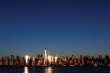 The midtown Manhattan skyline is seen at sunset in New York