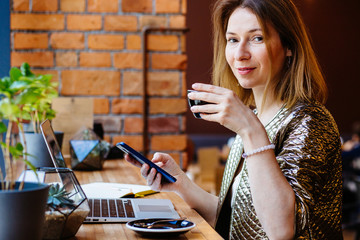 Portrait of positive thoughtful female distance worker reading received email while checking mail box via application on laptop computer, successful woman creating content for publication on website.