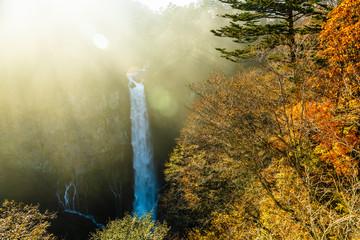 beautiful autumn landscape of waterfall and sun beams, Kegon, Nikko, Japan, nature background