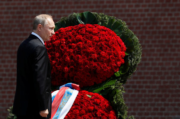Russian President Vladimir Putin attends a wreath laying ceremony marking the anniversary of the Nazi German invasion in 1941, at the Tomb of the Unknown Soldier by the Kremlin wall in Moscow