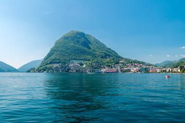 Foto op Canvas Cappuccino Mountain San Salvatore and lake Lugano in Switzerland.