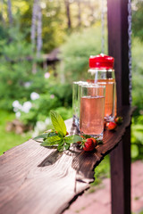 Glasses and jug of fruit juice. Summertime. Vertical orientation