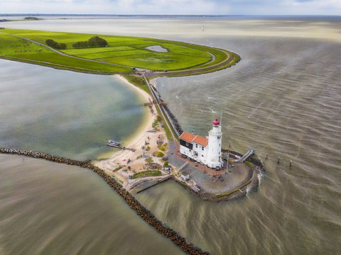 Aerial view of the lighthouse in Marken, a small island in the middle of the Markermeer in the Netherlands.