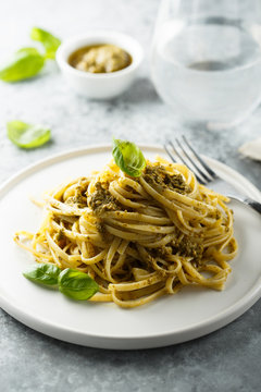 Homemade pasta with pesto sauce