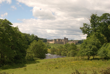 Alnwick castle and river Aln in Northumberland in summer