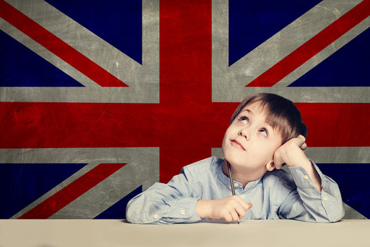 English concept with smart kid student against the UK flag background