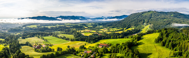 Aerial Bad Toelz Bavarian Alps. Golf Course. Blomberg Mountain. Morning Drone Shot with some clouds in the sky