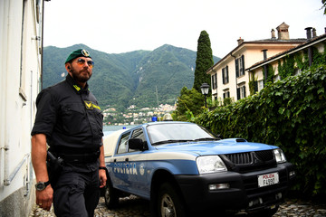 Italian Finance Police personnel stands near Villa Oleandra, the home of U.S. movie star George Clooney, ahead of the arrival of the Obama family in the northern Italian lakefront hamlet of Laglio