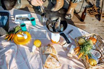 Beautiful picnic with fresh caught fish and vegetables