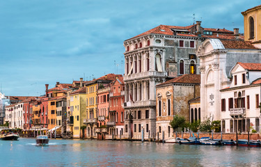 Fototapete - Venice in summer evening, Italy. Panorama of the famous Grand Canal, main street of Venice. Cityscape of Venice with old colorful houses in sunset light. Beautiful vintage buildings of Venice.