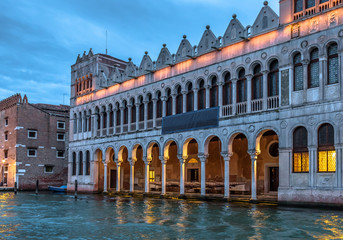 Fototapete - Museum of Natural History at night, Venice, Italy. It is tourist attraction of Venice. Vintage building like Venetian palace with lighting in evening. Old architecture and landmark of Venice at dusk.