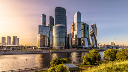 Wall Mural - Moscow-City skyscrapers at sunset, Russia. Moscow-City is modern business district at Moskva River. Panoramic view of tall buildings in the Moscow center. Urban landscape of Moscow in summer evening.