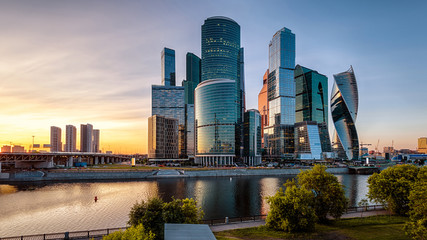 Fototapete - Moscow-City skyscrapers at sunset, Russia. Moscow-City is a business district on embankment of Moskva River. Modern tall buildings of Moscow at dusk. Urban landscape of Moscow in summer evening.