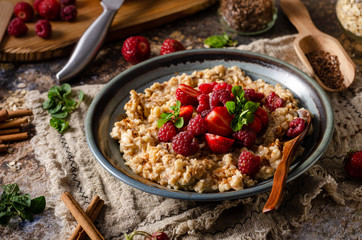 Homemade porridge with forest berries
