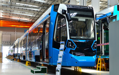 08.06.2019. Minsk, Belarus: Swiss rail vehicle manufacturer Stadler executes awarded the contract to manufacture and deliver tramway «Metelista» for the Cochabamba Metropolitan Train project, Bolivia Wall mural