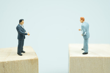 Miniature people businessmen talk invest contract agreement
