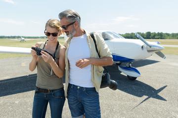 small aircraft tourist passenger looking at photos