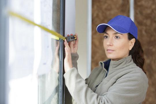 female construction worker installing new windows