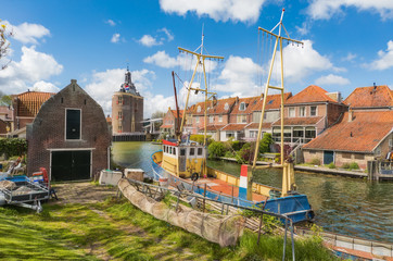 Fishing boat in Enkhuizen in the Netherlands with the historic city gate (Drommedaris) in the background..