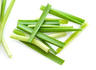 Fototapeta Fresh healthy organic green vegetable garlic chives, chinese chive sliced, green herb isolated on white background. obraz